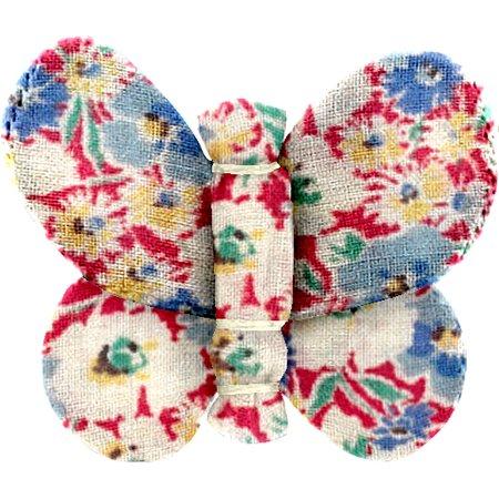Barrette petit papillon oeillets jean