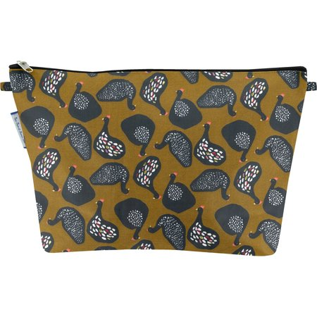 Cosmetic bag with flap hen facet