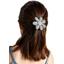 Barrette fleur marguerite etoile or gris