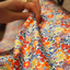 Tissu coton au mètre fleuri orange bleu blanc ex1064