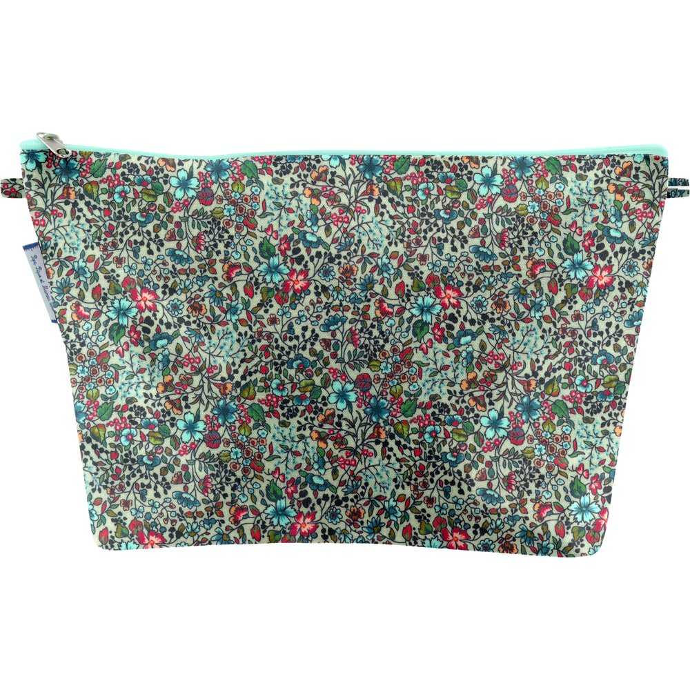 Cosmetic bag with flap flower mentholated